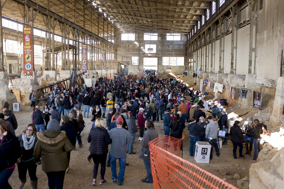 Patrons are seen in lines inside the Woolery Mill during the 6th Annual Bloomington Craft Beer Festival on Saturday, April 9, 2016, in Bloomington, Indiana. (Photo by James Brosher)